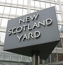210px-new_scotland_yard_sign_3_217